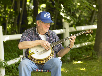 Jimmy Cox picking his Fairchild banjo.